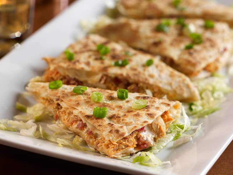 Chicken bacon quesadilla with chives and lettuce